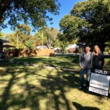 Joel and Michelle Hartz the Wandering Hartz with Sold Sign