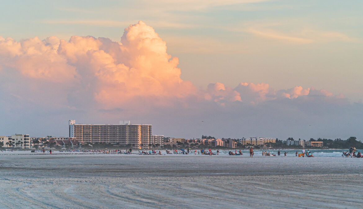 Clouds illuminated by the sun durring sunset above the many condo along Siesta Key beach