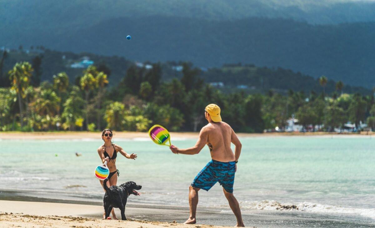 Couple enjoying Luquillo beach with dog